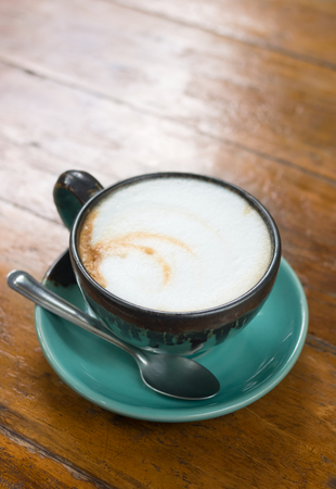 Cappuccino coffee in green cup Stock Photo