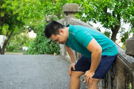 Asian man tired from running exercise. Reklamní fotografie