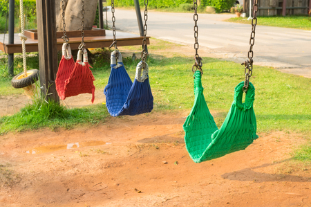 Multi color swings in playground.