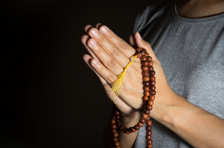 Necklace in woman hand,religion concept.