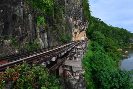 tributary: The railway along with the cliff and  the small tributary kwai noi river