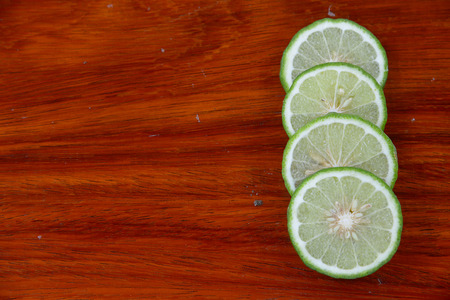 wooden insert: Lime leaves on the wooden floor With the insert text Stock Photo