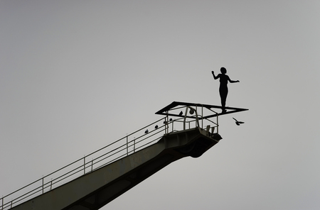 Shadow woman on high place