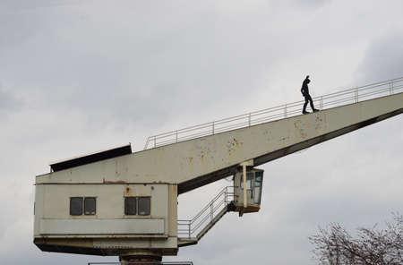 disheartened: Example image The road to success Man on crane upwards