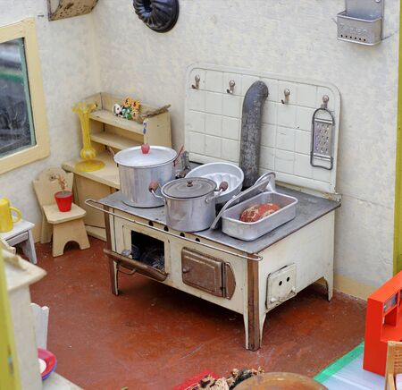 flea: Old flea marked play oven for children Stock Photo