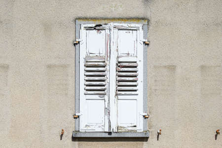 flaked: Window shutter, old and crapped, color flaked off. Stock Photo