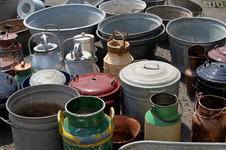 tired businessman: Collection of old flea market churns Stock Photo