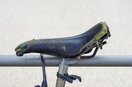 Old blue seat at a bycicle Stock Photo