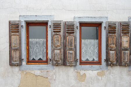 flaked: Two old worn window shutter in a row Stock Photo