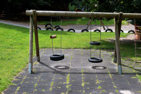 without: Simple swing  at a kindergarten in summer time without children