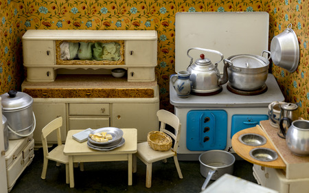 Grandmother's Old Dolls Kitchen with accessories. Toys for girls from the 40s or 50s.