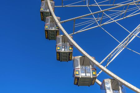 Some gondolas at a Ferris wheel at the spring fair in Mainz, Rhineland Palatinate, Germany