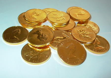 Stack of gold ounces Canada Maple Leaf Elizabeth II. Pur fine Gold 31,1 Gramm
