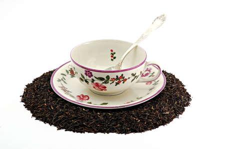 Tea cup on scattered tea leafs photo