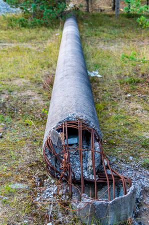 reinforcement: Broken pole with visible reinforcement bars Stock Photo