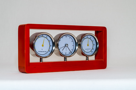 hygrometer: thermometer clock  hygrometer isolated on white background Stock Photo