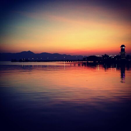furthest: A picture of sunset over a lighthouse in Trad the furthest eastern seaboard of Thailand