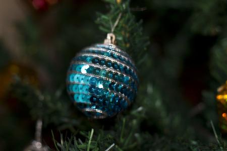 glitter christmas ball in christmas tree