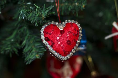 heart chritmas ornamnet in christmas tree
