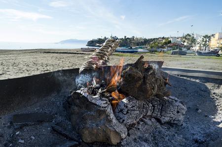 'costa del sol': Roasting sardines on the costa del sol Malaga Spain