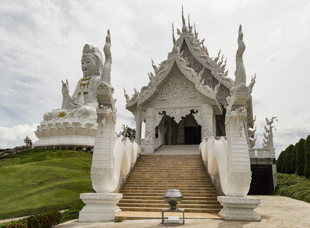 Wat Huay Pla Kang 9 Tier Temple is located on the outskirts of Chiang Rai and has a nine-level chedi that can be climbed climbing its bowels. Stock Photo