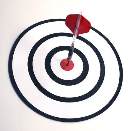 Dart in the bull s eye center of target  Business success concept