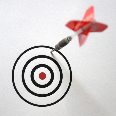 Dart in the bull s eye center of target  Business success concept Stock Photo - 21169762