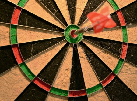 X marks the spot on a dartboard bullseye Stock Photo