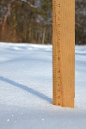 severe weather: A ruler in the snow measuring 11 centimetres depth Stock Photo