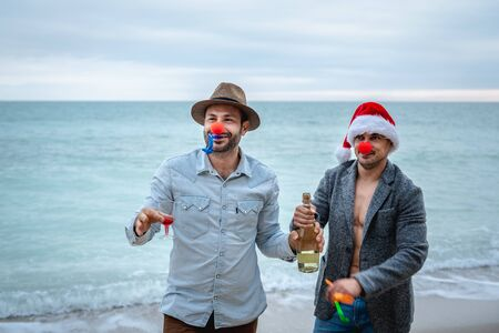 Two friends on the beach celebrate New Year