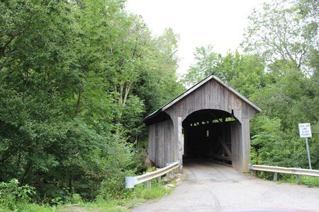 lumber mill: Lumber Mill Covered Bridge Belvidere, VT 1895 Stock Photo