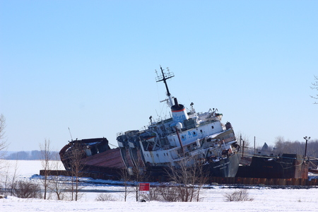BEAUHARNOIS, Quebec, Canada, March 19th, 2017. Kathryn Spirit abandoned ship still waiting to be dismantled and menacing to capsize. Editorial