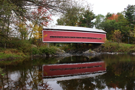 Covered Bridge Reflecting in River