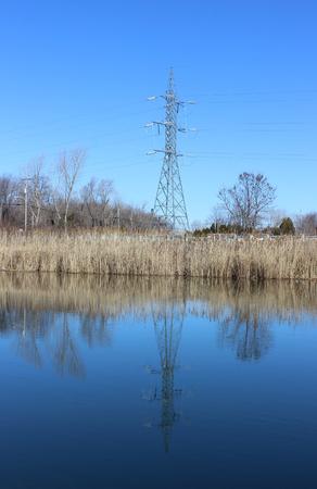 Pylon reflecting on water