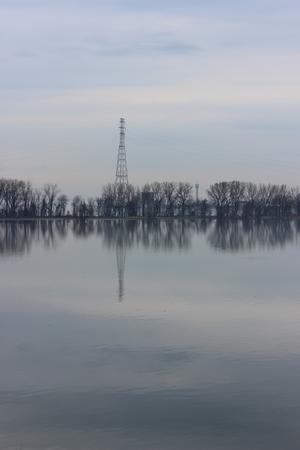 Pylon reflecting on a foggy morning Stock fotó
