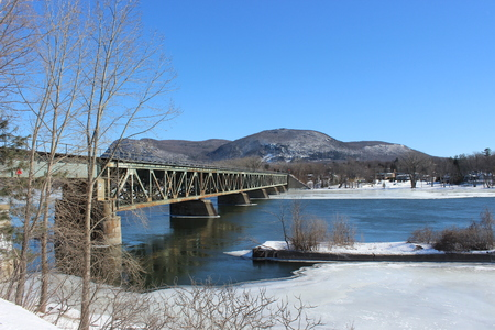 Mont St-Hilaire in winter with the railway bridge viewed from across the Richelieu River