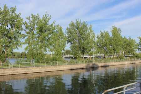 Historical Chambly Canal near St-Jean-sur-Richelieu, Quebec, Canada in summer with nature reflecting on the water