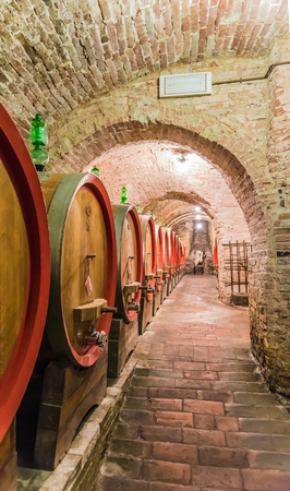 montalcino: The barrel containing the red Montepulciano wine noble in Siena, Tuscany Stock Photo