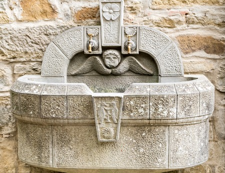 carved stone: public water fountain carved stone with two spouts Stock Photo
