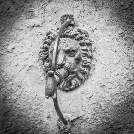 antichrist: Sculpture on a wall in the town of Cortona in Tuscany - Italy