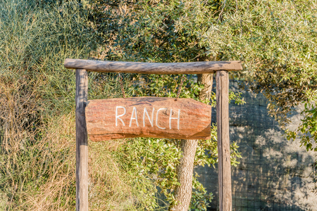 animal private: Indication of ranch made with a wooden board and written in white