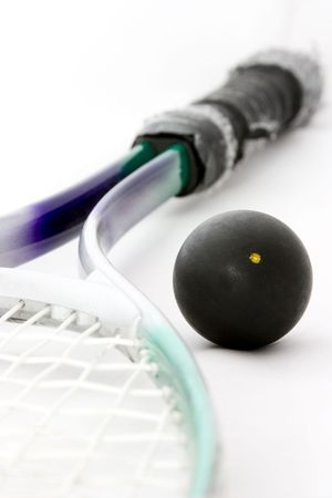 raquet: Black squash ball with raquet