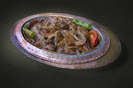 Turkish Iskender kebab on the vintage copper plate Stock Photo