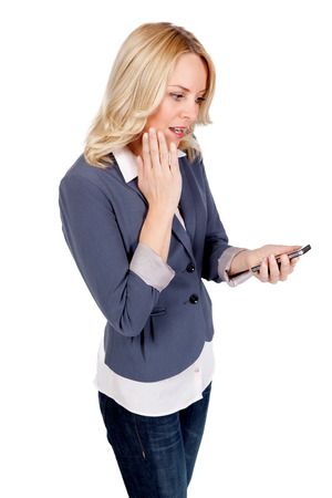 Young blonde woman staring at her mobile phone photo