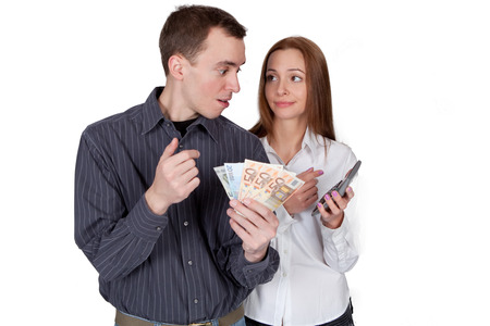Young couple with money and calculator photo