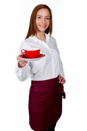 Young attractive waitress with a cup in her hand  photo