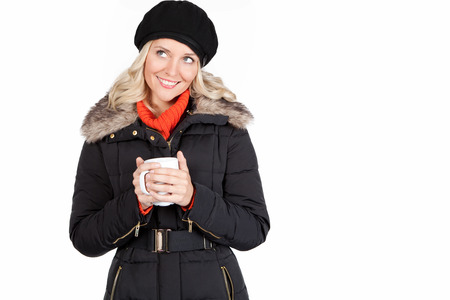 Young womand holding a cup in her hands photo