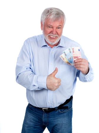 pension cuts: Laughing man with money in hand showing the thumbs up Stock Photo