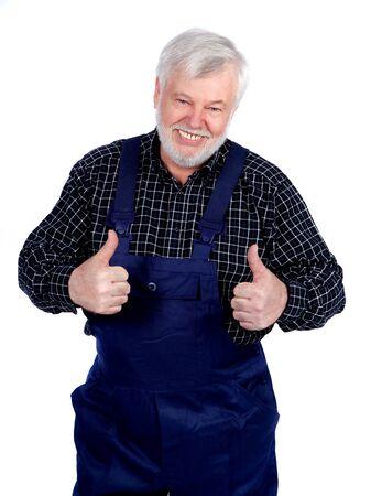 positiv: Handwerker zeigt mit beiden Daumen nach oben Stock Photo