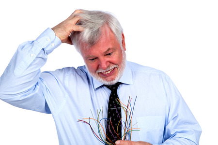 pension cuts: Man with cables in hand tearing her hair Stock Photo